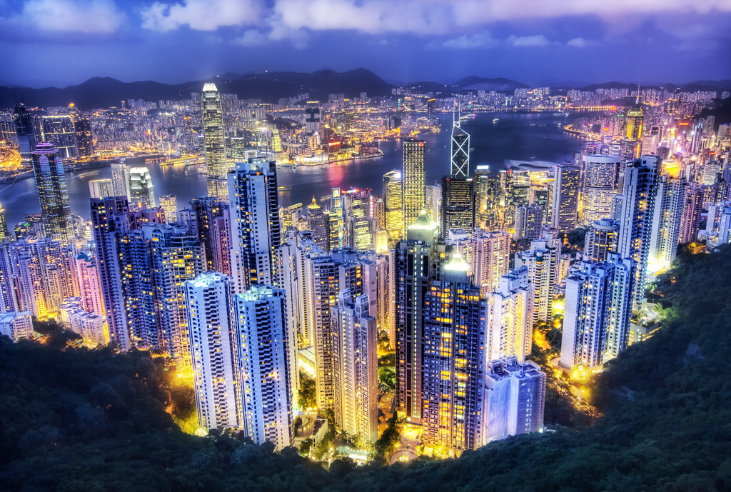 An aerial view of Hong Kong by night.