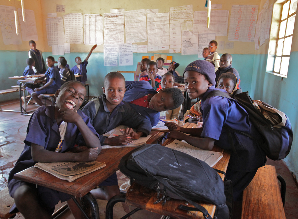 A school in Zambia with happy, smiling children.