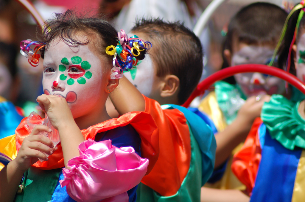 A group of colorfully dressed children in a Costa Rican festival.