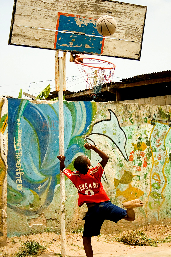 Tanzanian child playing basketball.